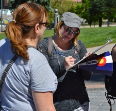 Signing a petition at a rally for health care reform in Denver.